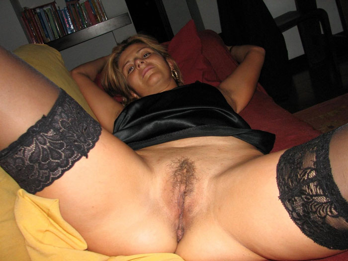 horny housewife lying on the couch